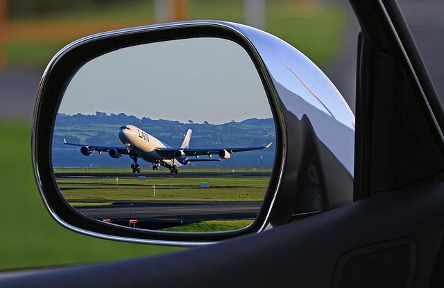 Plane in Rearview Mirror